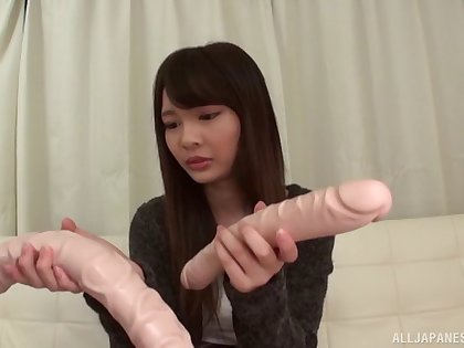 Shuri Atomi gets her wet pussy pleased by a long friend's toy