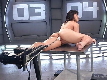 Busty Asian babe Mia Little gets carbon copy penetrated  by two fuck machines